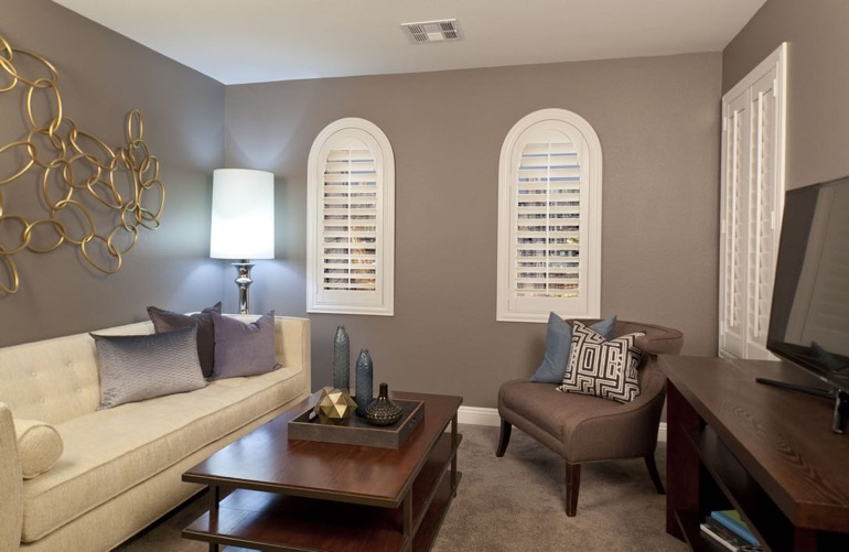 San Antonio family room with arced plantation shutters.