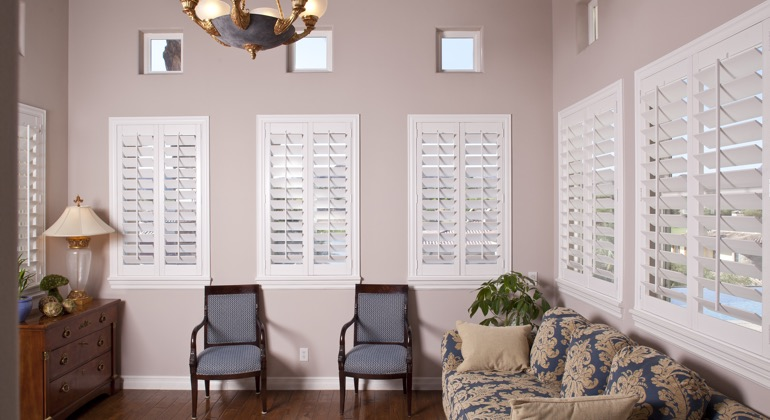 Chic sunroom with plantation shutters