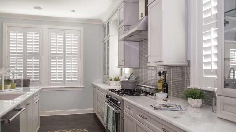 White shutters in San Antonio kitchen with marble counter.