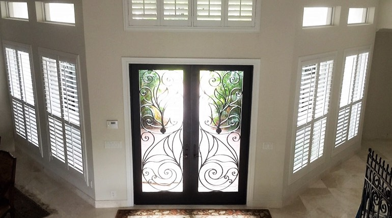 San Antonio foyer with glass doors and interior shutters