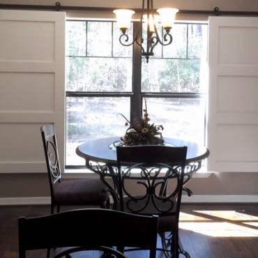 San Antonio dining room barn door shutters.