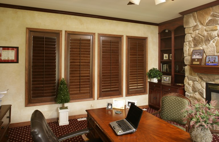 Wooden plantation shutters in a San Antonio home office