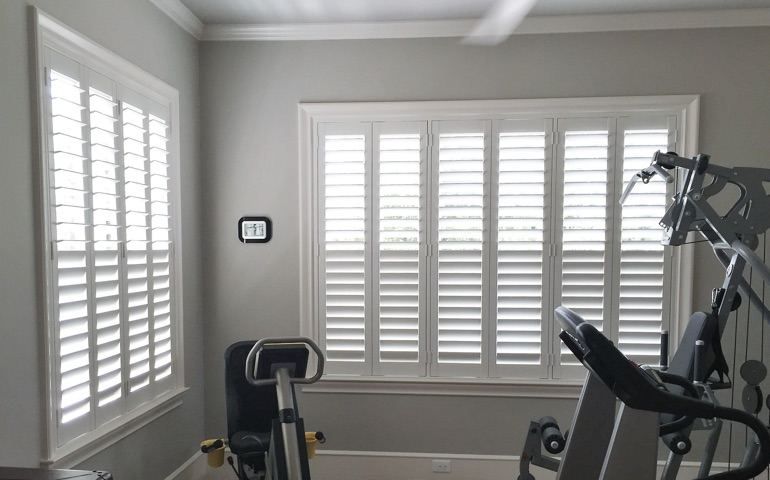 San Antonio home gym with shuttered windows.