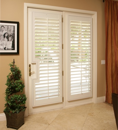 Plantation shutters on a french door leading out to pool