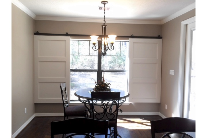 San Antonio dining room with moveable barn door shutters.