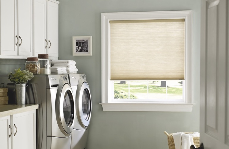 San Antonio laundry room with pull-down window shades.