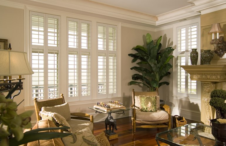 Living Room in San Antonio with white plantation shutters.