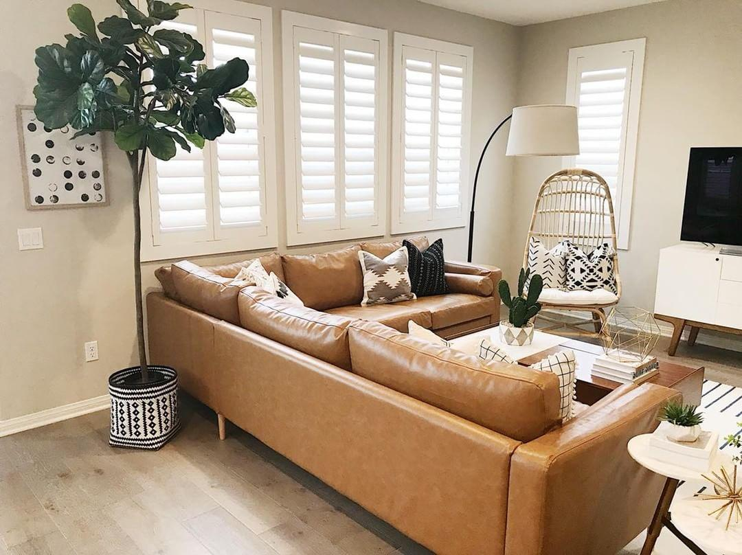 Warm living room with our Polywood shutters in San Antonio.