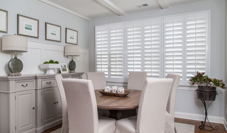 Plantation shutters in a San Antonio dining room.