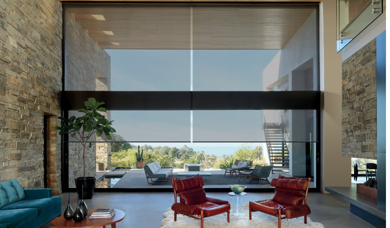 Motorized shades in a San Antonio family room.