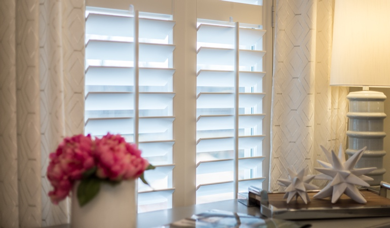 Plantation shutters by flowers in San Antonio