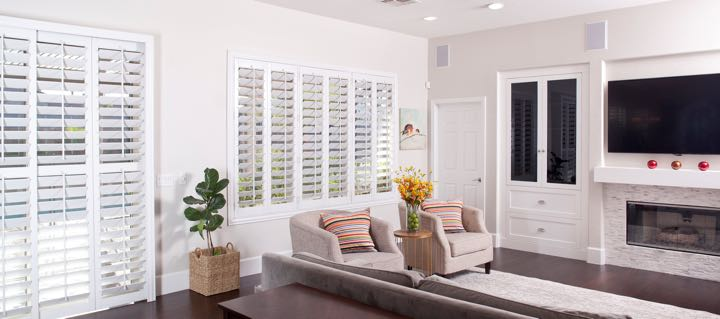 San Antonio living room in white with plantation shutters.