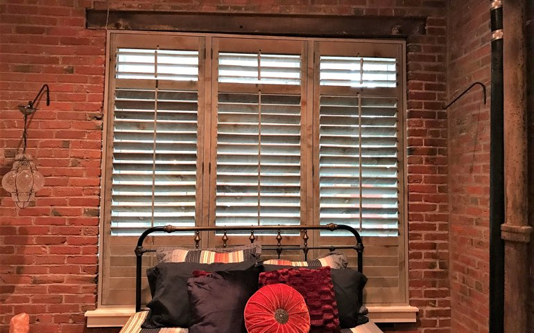 repurposed wood shutters in San Antonio bedroom