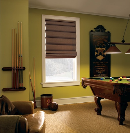 Roman shades in San Antonio game room with green walls.