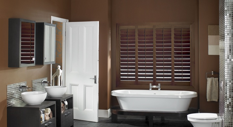 Stained wood shutter in San Antonio bathroom