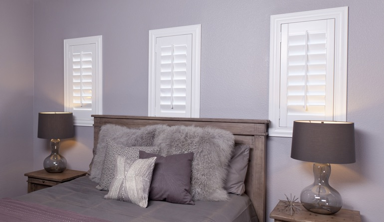 Studio plantation shutters in San Antonio bedroom windows.