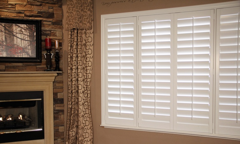 San Antonio Studio plantation shutters in living room.