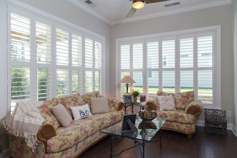 Traditional sunroom with plantation shutters in San Antonio.