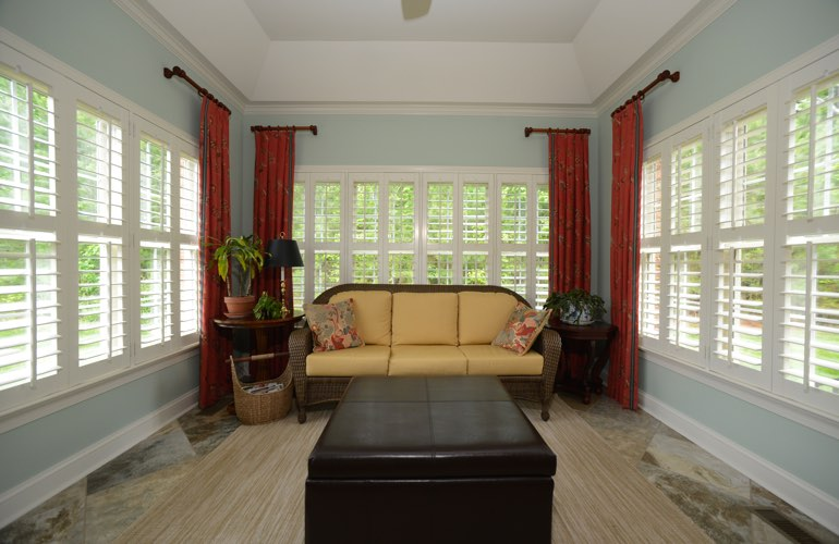 San Antonio sunroom with plantation window shutters.