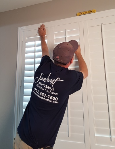 Shutter installation in San Antonio bedroom.