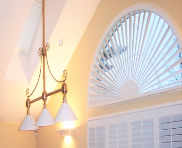 San Antonio arched eyebrow window with classic shutter