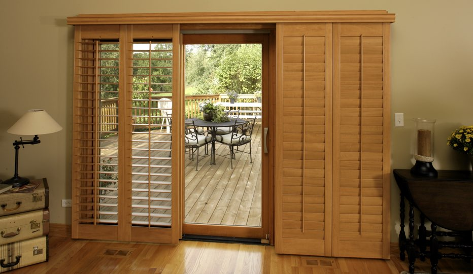 Wood bypass patio door shutters in San Antonio living room