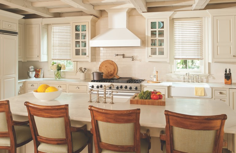 A modern kitchen with blinds
