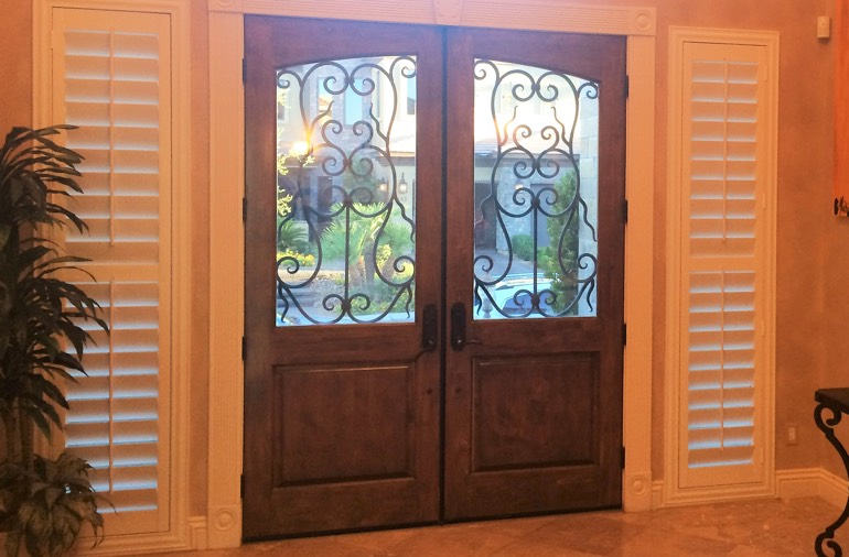 Sidelight window shutters in San Antonio house