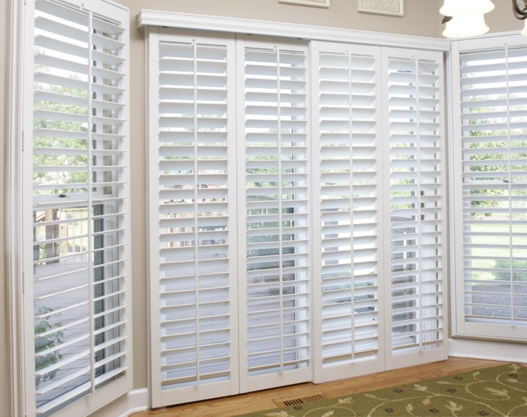 Sliding glass door with white shutters San Antonio