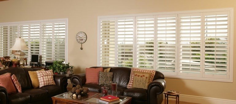 Wide Window With White Shutters In San Antonio Living Room